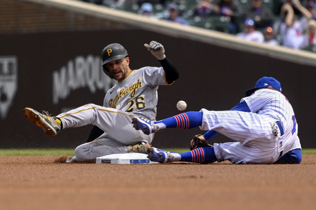 Pittsburgh Pirates Adam Frazier (26) slides safely into second base past Chicago Cubs infielder Eric Sogard (4) during the first inning of a baseball ...