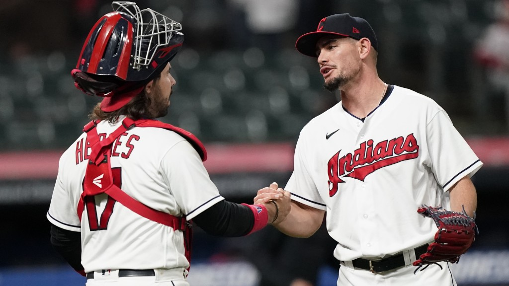 Cleveland Indians relief pitcher Nick Wittgren, right, is congratulated by catcher Austin Hedges after the Indians defeated the Cincinnati Reds 9-2 in...