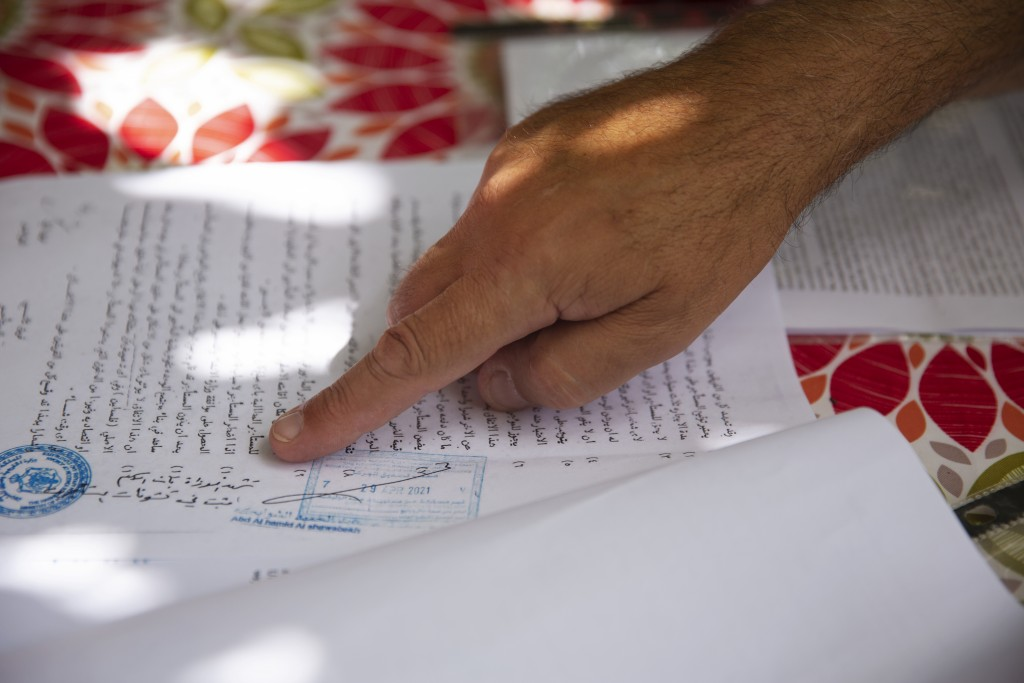 Adel Budeiri points to a document in a court case for several Palestinian families, including his own, who are at risk of forcible eviction from their...