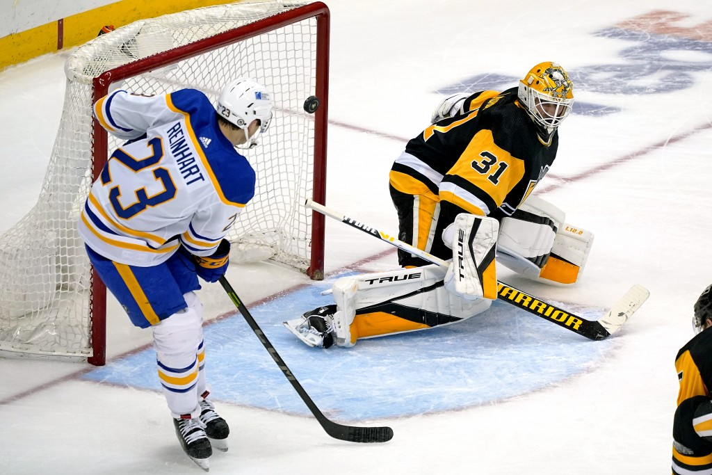 Pittsburgh Penguins goaltender Maxime Lagace (31) blocks a shot by Buffalo Sabres' Sam Reinhart (23) during the third period of an NHL hockey game in ...