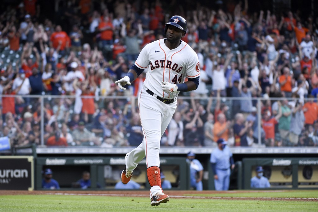 Houston Astros' Yordan Alvarez gestures toward the team's dugout while rounding the bases after hitting a two-run home run during the fourth inning of...