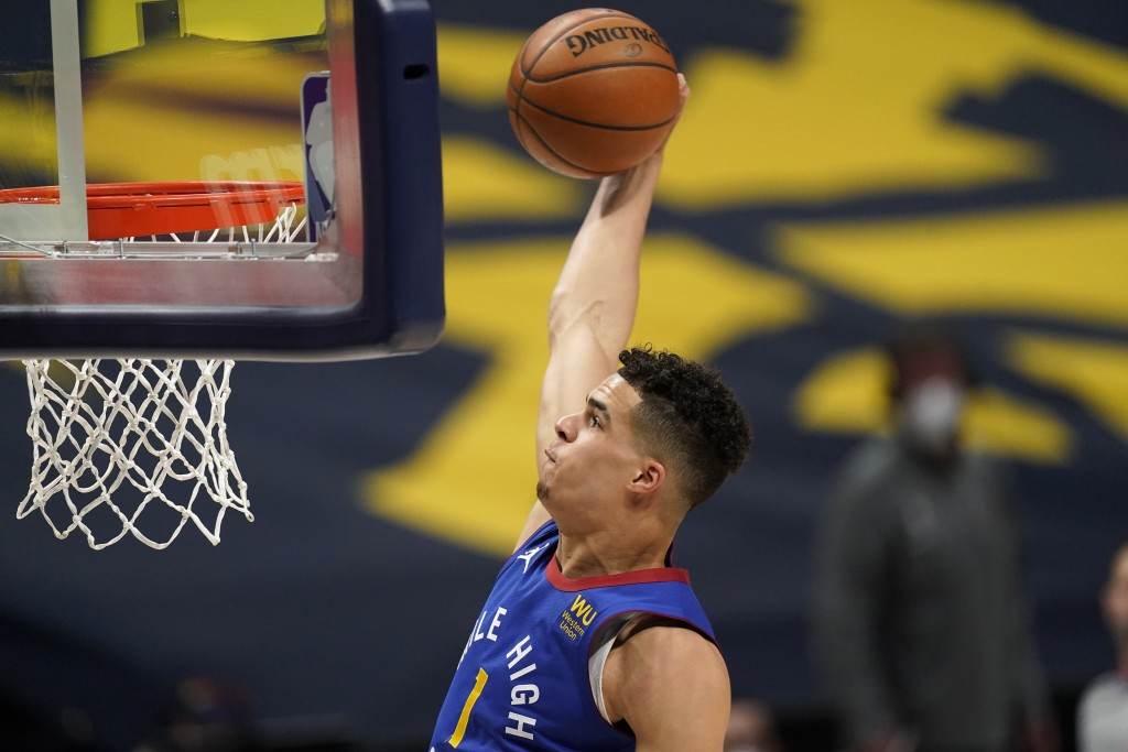 Denver Nuggets forward Michael Porter Jr. dunks against the Brooklyn Nets during the first half of an NBA basketball game Saturday, May 8, 2021, in De...