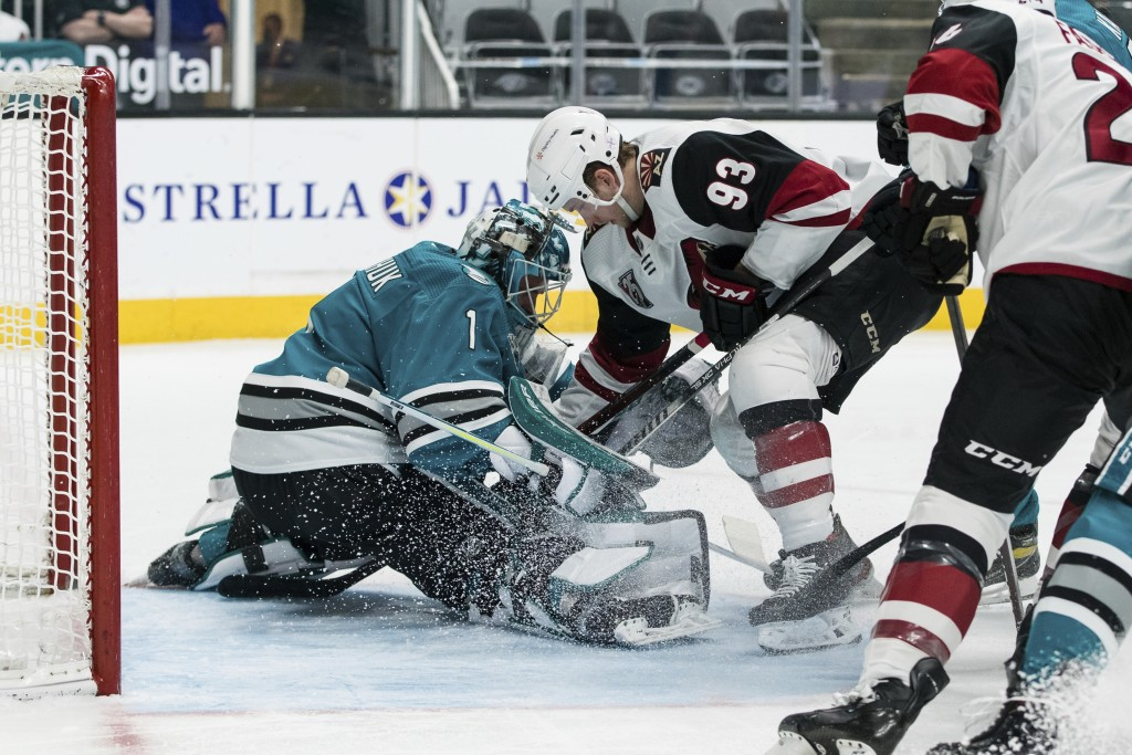 San Jose Sharks goaltender Alexei Melnichuk (1) guards against a shot by Arizona Coyotes center Lane Pederson (93) during the second period of an NHL ...