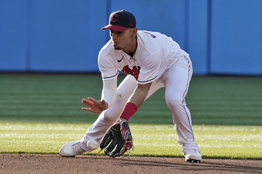 Cleveland Indians' Andres Gimenez fields a ball hit by Cincinnati Reds' Tyler Stephenson, who was out at first during the fourth inning of a baseball ...