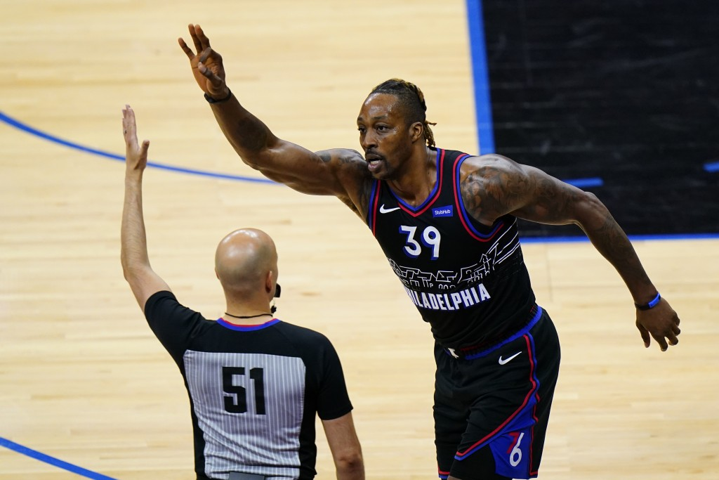 Philadelphia 76ers' Dwight Howard (39) reacts after making a three-pointer during the second half of an NBA basketball game against the Detroit Piston...