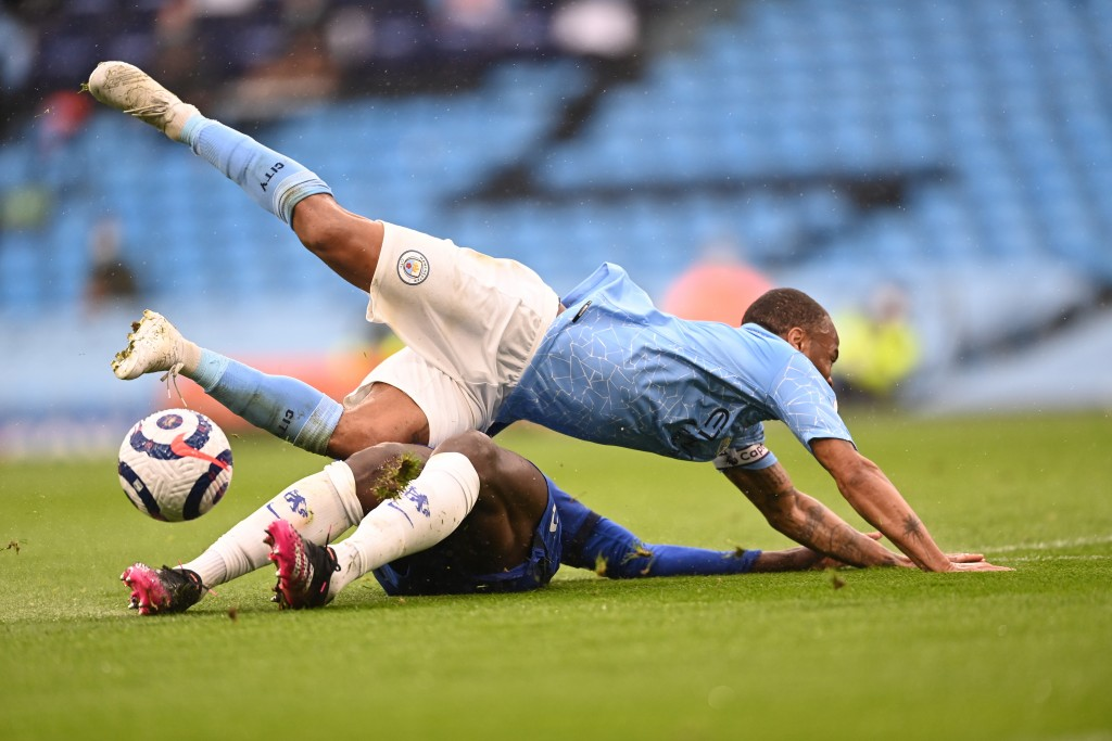 Manchester City's Raheem Sterling, top, and Chelsea's Kurt Zouma challenge for the ball during the English Premier League soccer match between Manches...