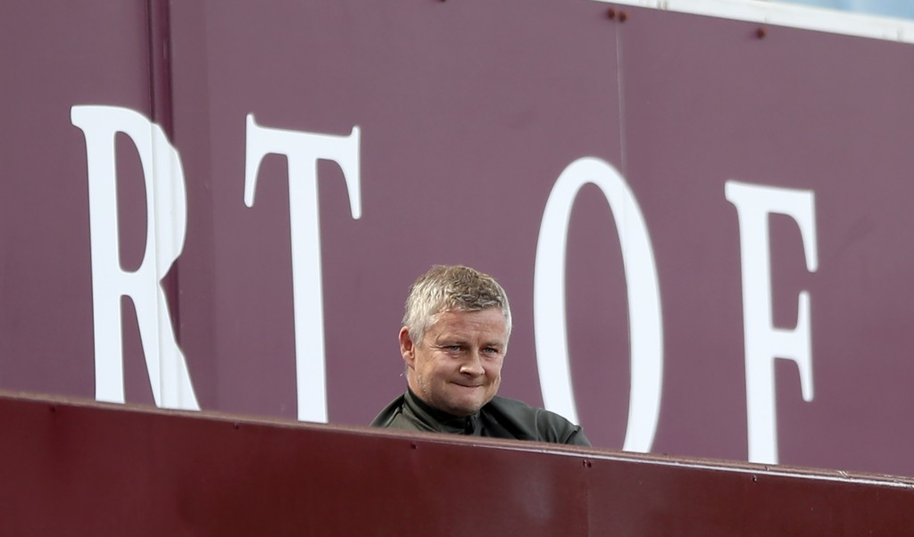 Manchester United's manager Ole Gunnar Solskjaer looks out from the stands during the English Premier League soccer match between Aston Villa and Manc...