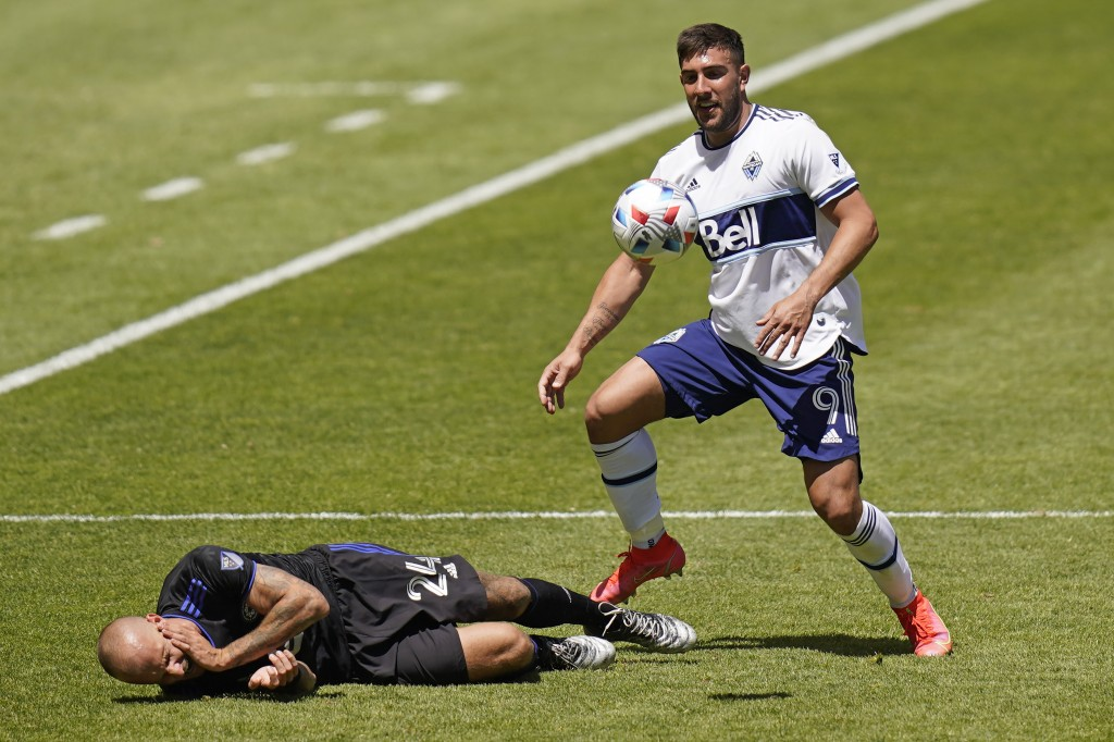 Vancouver Whitecaps forward Lucas Cavallini (9) fouls CF Montréal defender Aljaz Struna (24) in the first half during an MLS soccer game Saturday, May...