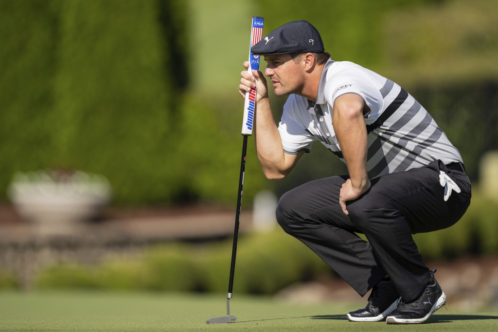 Bryson DeChambeau lines up his putt on the seventh hole during the third round of the Wells Fargo Championship golf tournament at Quail Hollow, Saturd...