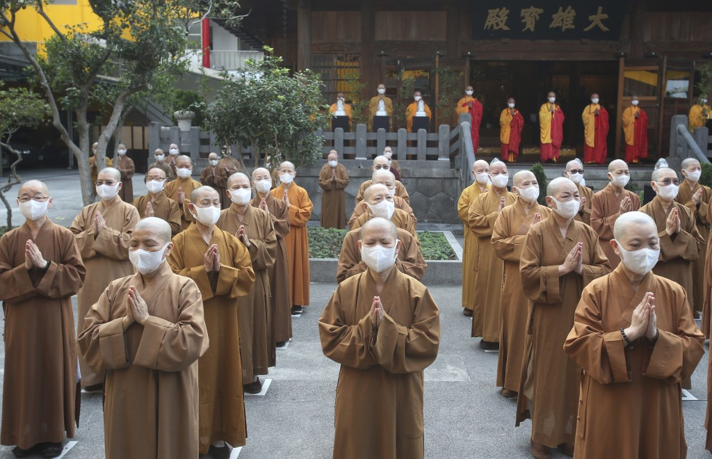 Monks and nuns pray together during Buddha's Birthday celebrations at the Lin Chi Temple in Taipei, Taiwan, Sunday, May 9, 2021. Buddha's birthday is ...