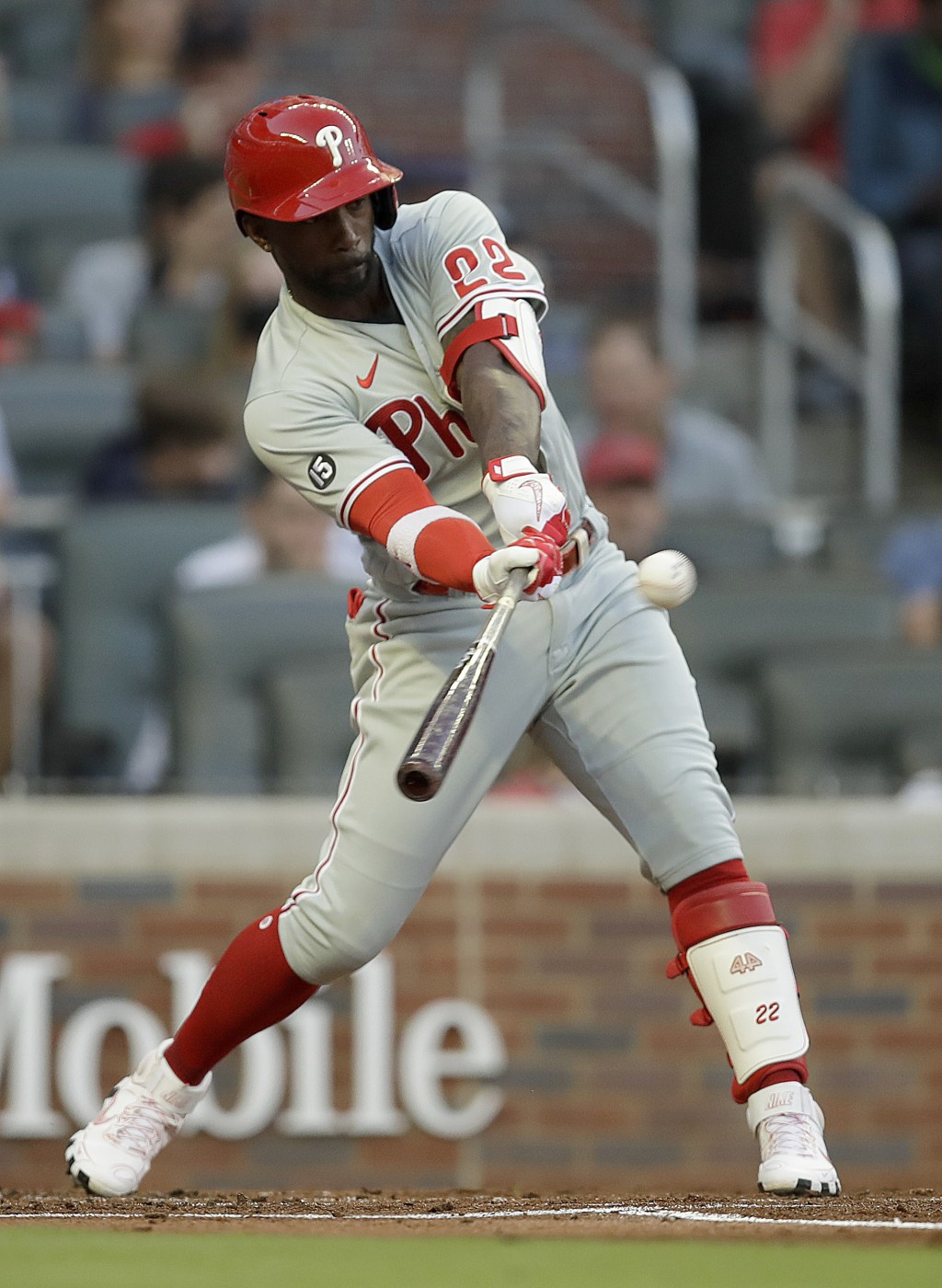 Philadelphia Phillies' Andrew McCutchen swings for an RBI-single off Atlanta Braves pitcher Ian Anderson in the second inning of a baseball game Satur...