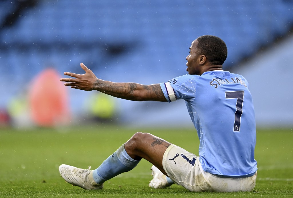 Manchester City's Raheem Sterling reacts during the English Premier League soccer match between Manchester City and Chelsea at the Etihad Stadium in M...