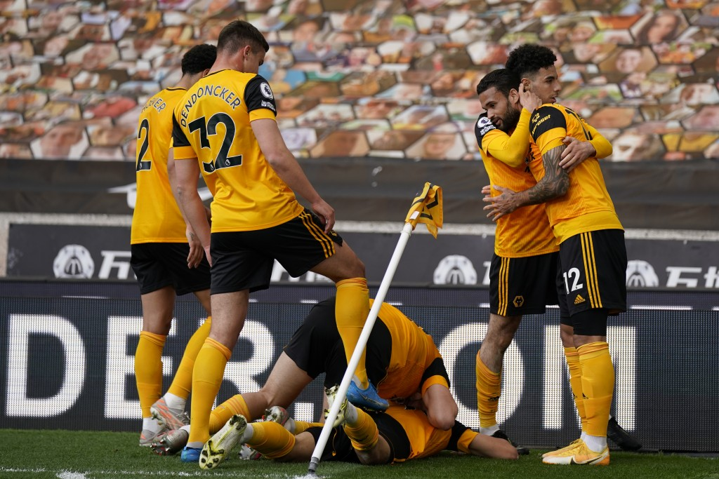 Wolverhampton Wanderers players celebrate after Morgan Gibbs-White scored his side's second goal during the English Premier League soccer match betwee...