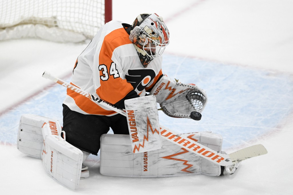 Philadelphia Flyers goaltender Alex Lyon stops the puck during the first period of the team's NHL hockey game against the Washington Capitals, Saturda...