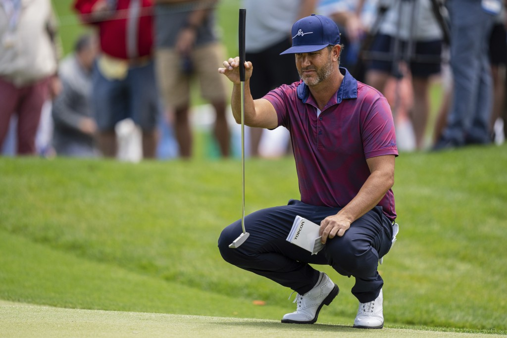 Scott Piercy lines up his putt on the first hole during the third round of the Wells Fargo Championship golf tournament at Quail Hollow on Saturday, M...