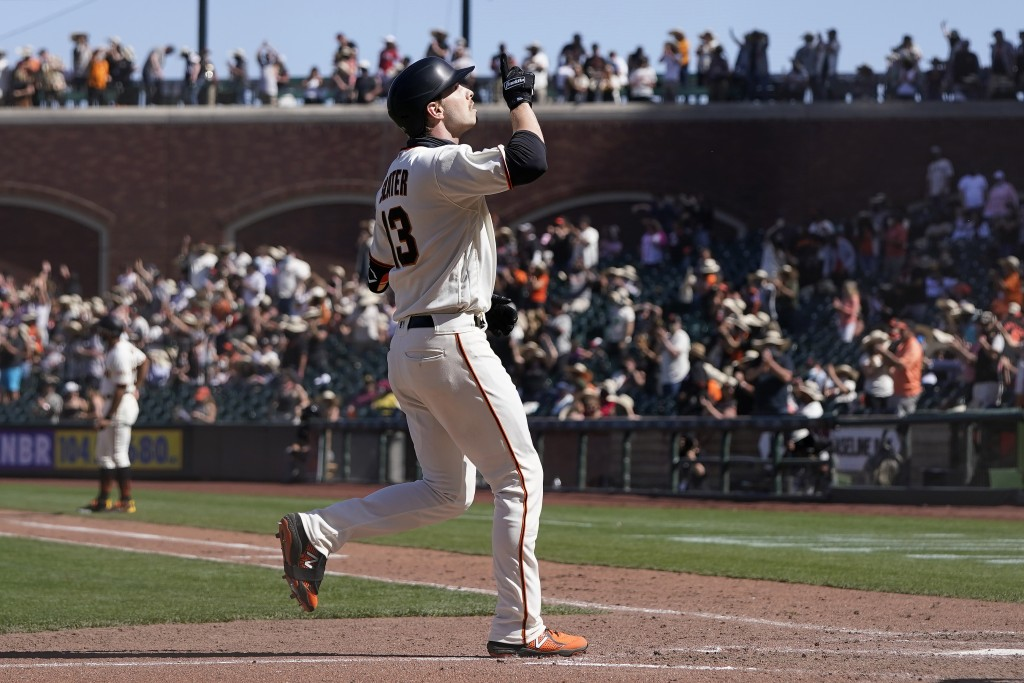 San Francisco Giants' Austin Slater gestures after hitting a two-run home run against the San Diego Padres during the eighth inning of a baseball game...