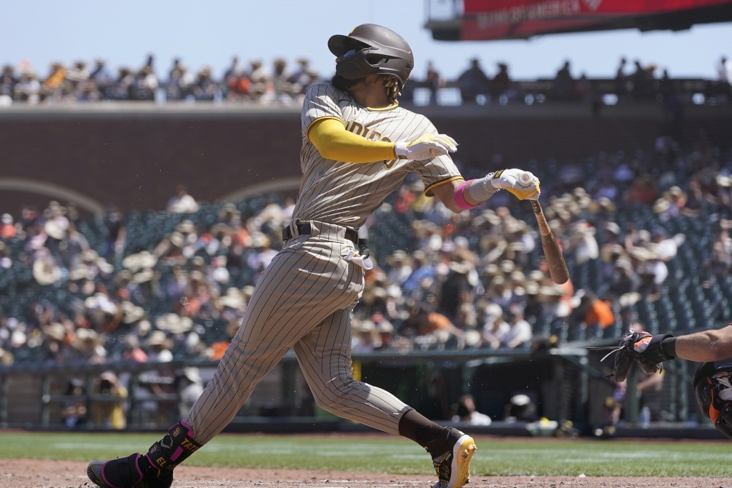 San Diego Padres' Fernando Tatis Jr. hits a single against the San Francisco Giants during the sixth inning of a baseball game in San Francisco, Satur...