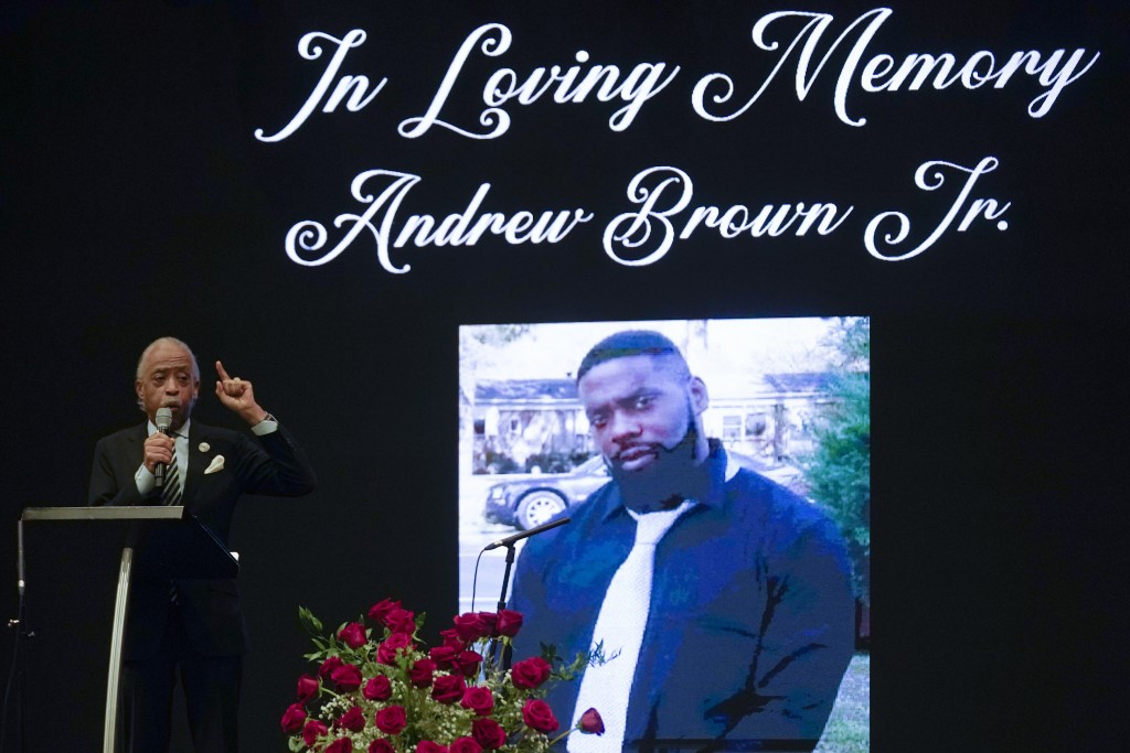 File-This May 3, 2021, file photo shows Rev. Al Sharpton speaking during the funeral for Andrew Brown Jr.,  at Fountain of Life Church in Elizabeth Ci...
