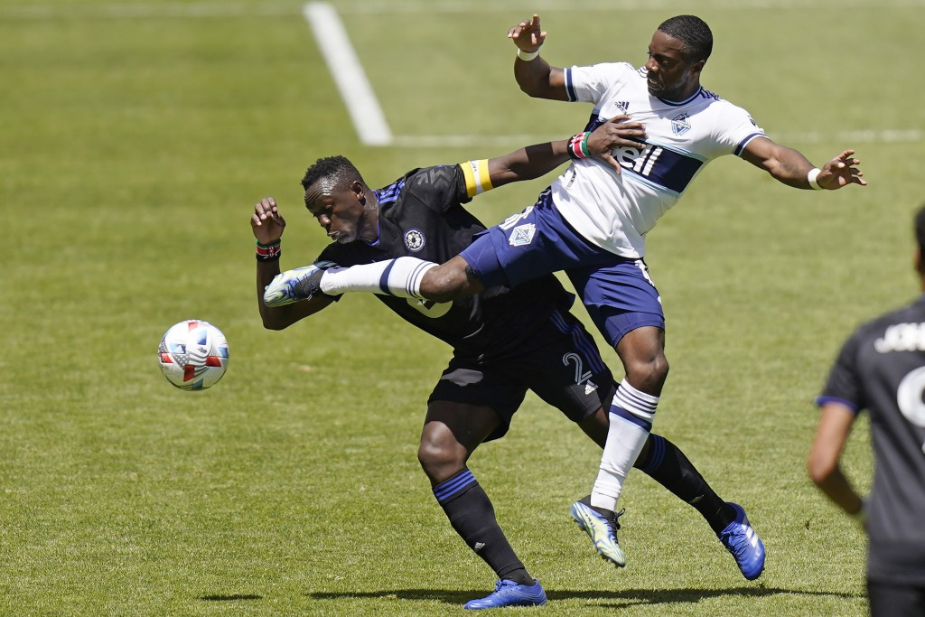 CF Montréal midfielder Victor Wanyama (2) and Vancouver Whitecaps forward Cristian Dajome, right, battle for the ball in the first half of an MLS socc...