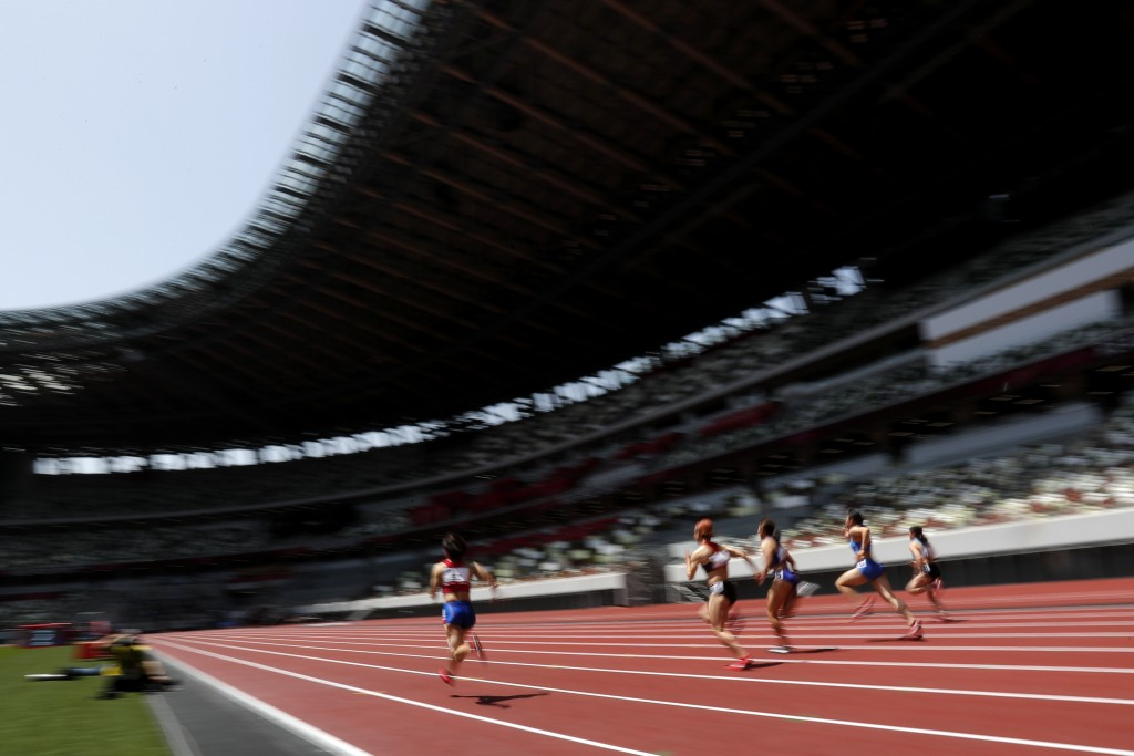 Japanese woman athletes compete during their 100 meter race at an athletics test event for the Tokyo 2020 Olympics Games at National Stadium in Tokyo,...