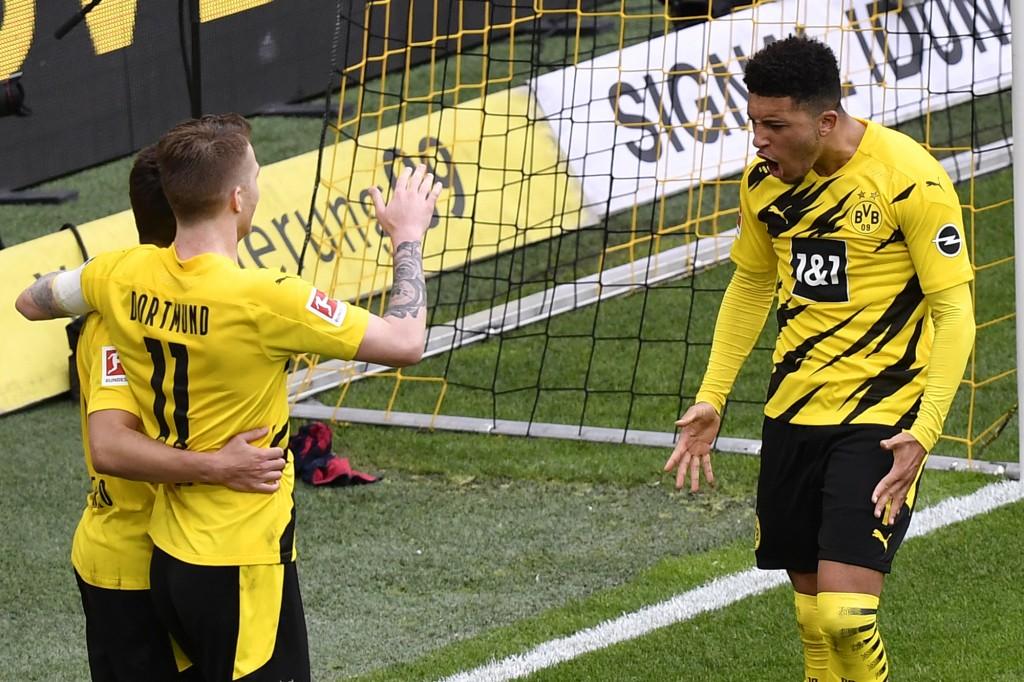Dortmund's Jadon Sancho, right, celebrates after scoring his side's third goal during the German Bundesliga soccer match between Borussia Dortmund and...