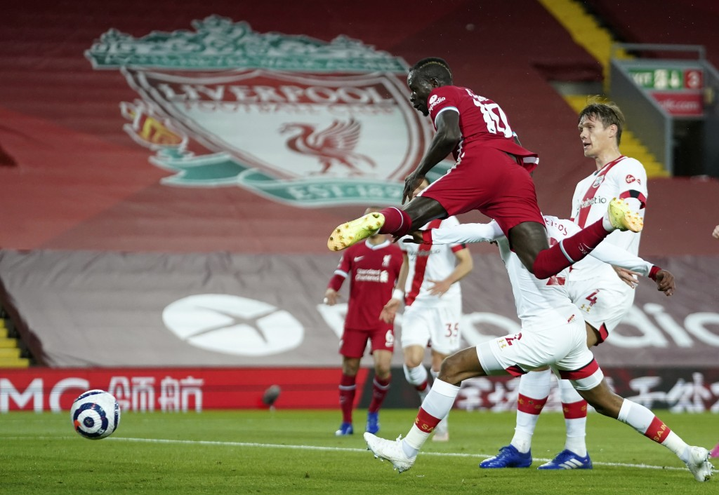 Liverpool's Sadio Mane, front, scores his side's opening goal during the English Premier League soccer match between Liverpool and Southampton at Anfi...