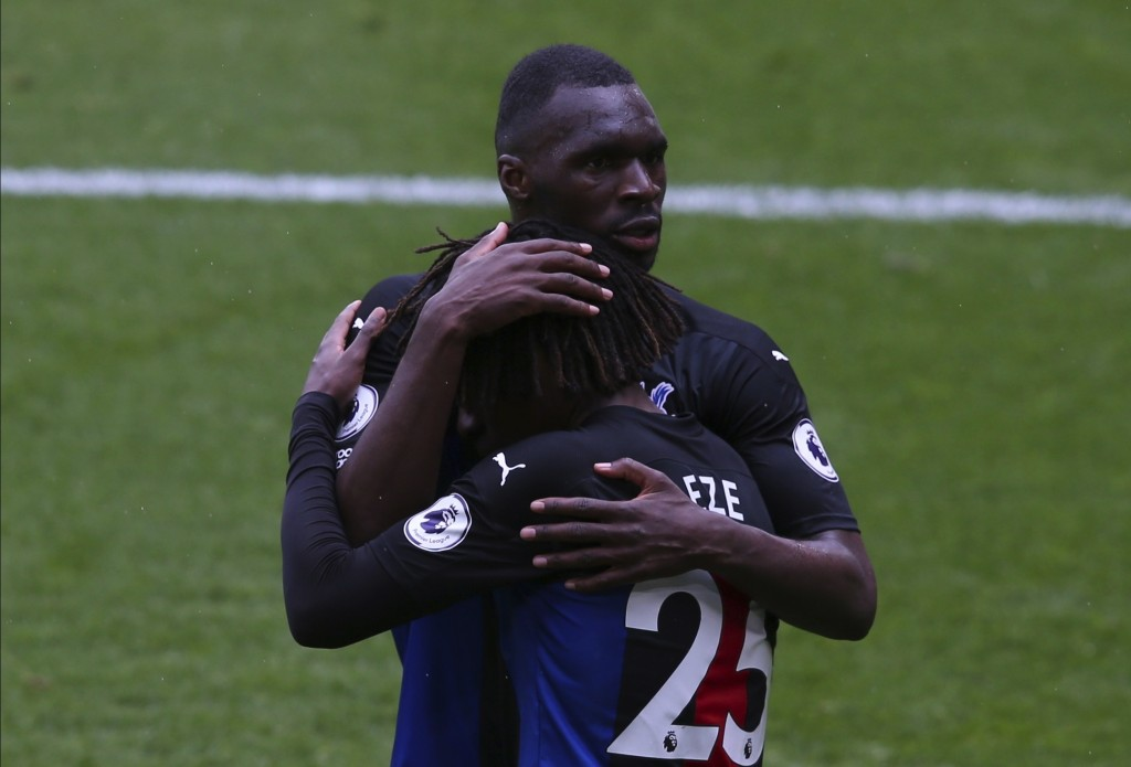 Crystal Palace's Eberechi Eze celebrates after scoring his side's second goal with Christian Benteke during the English Premier League soccer match be...