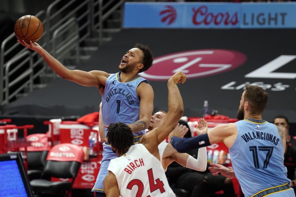 Memphis Grizzlies forward Kyle Anderson (1) puts up a shot over Toronto Raptors center Khem Birch (24) during the first half of an NBA basketball game...
