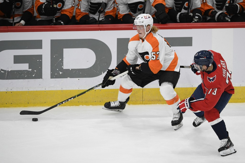 Philadelphia Flyers right wing Wade Allison (57) skates with the puck past Washington Capitals left wing Conor Sheary (73) during the first period of ...