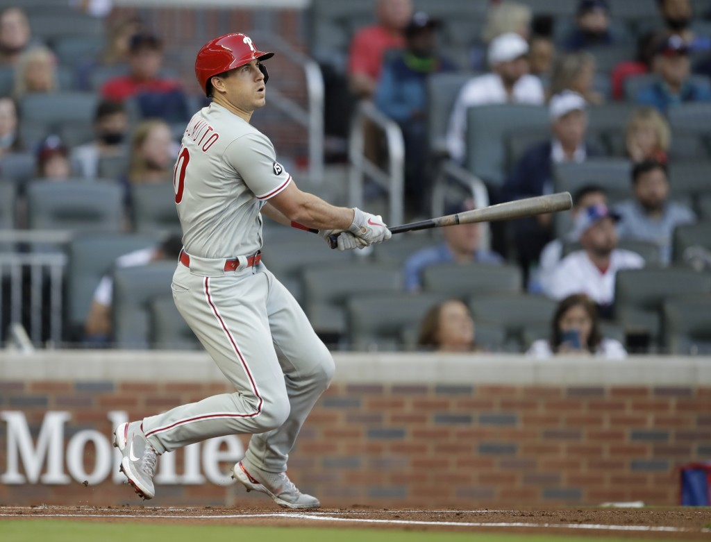 Philadelphia Phillies' J.T. Realmuto watches his double off Atlanta Braves pitcher Ian Anderson in the first inning of a baseball game Saturday, May 8...