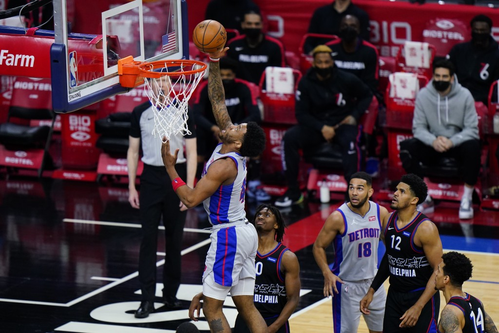 Detroit Pistons' Saddiq Bey, left, goes up for a shot past Philadelphia 76ers' Tyrese Maxey during the second half of an NBA basketball game, Saturday...