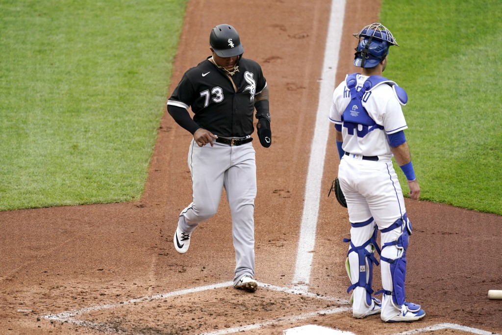 Chicago White Sox's Yermin Mercedes runs home to score past Kansas City Royals catcher Sebastian Rivero on a double by Andrew Vaughn during the first ...