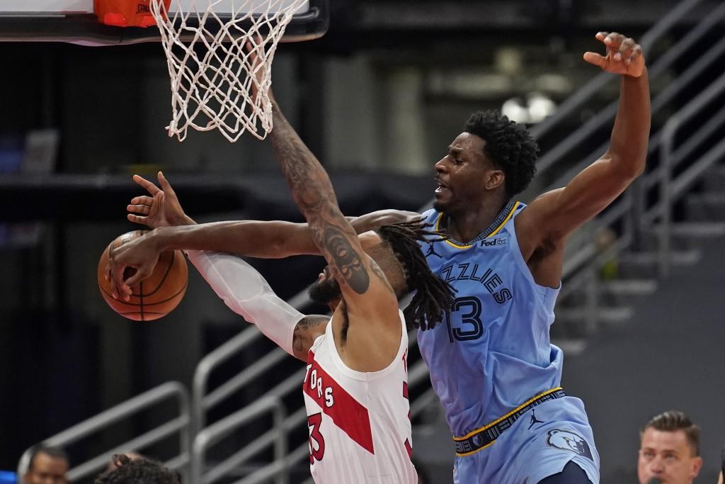 Memphis Grizzlies forward Jaren Jackson Jr. (13) blocks a shot by Toronto Raptors guard Gary Trent Jr. during the second half of an NBA basketball gam...