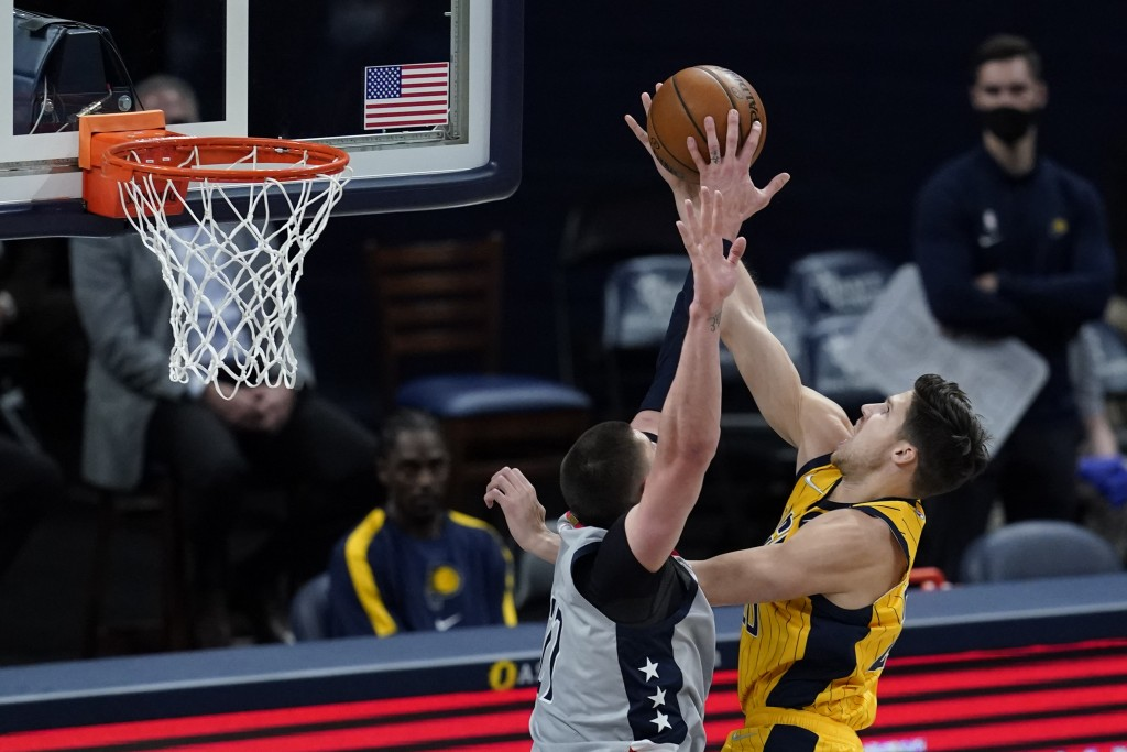 Indiana Pacers' Doug McDermott (20) has his shot blocked by Washington Wizards' Alex Len (27) during the first half of an NBA basketball game, Saturda...