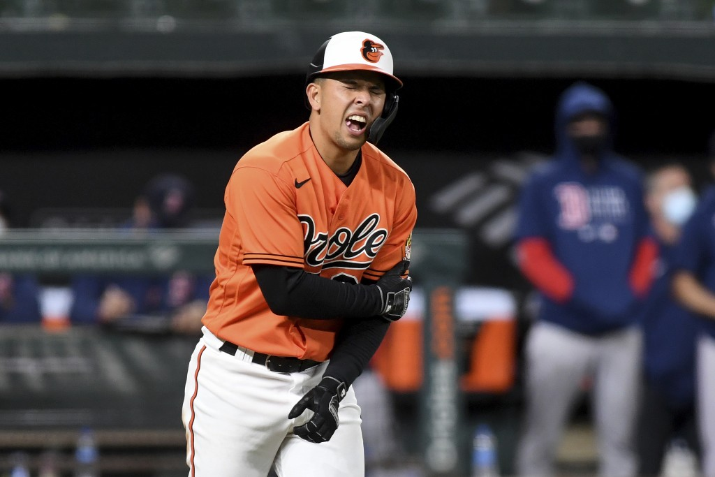Baltimore Orioles' Ramon Urias reacts after being hit by a pitch in the ninth inning of a baseball game against the Boston Red Sox, Saturday, May 8, 2...