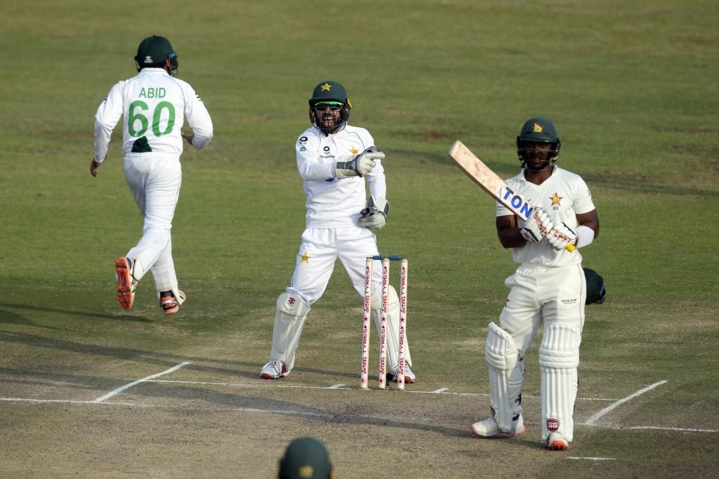 Pakistan wicketkeeper Mohammad Rizwan, centre, celebrates the wicket of Zimbabwe batsman Regis Chakabva during the second test cricket match against Z...