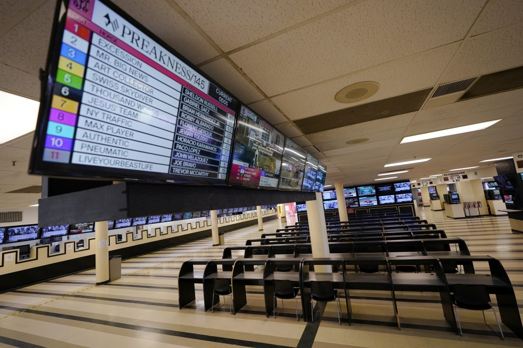 FILE - In this Oct. 2, 2020, file photo, betting tables are empty at Pimlico Race Course in Baltimore. Pimlico, which opened in 1870, is set to be reb...