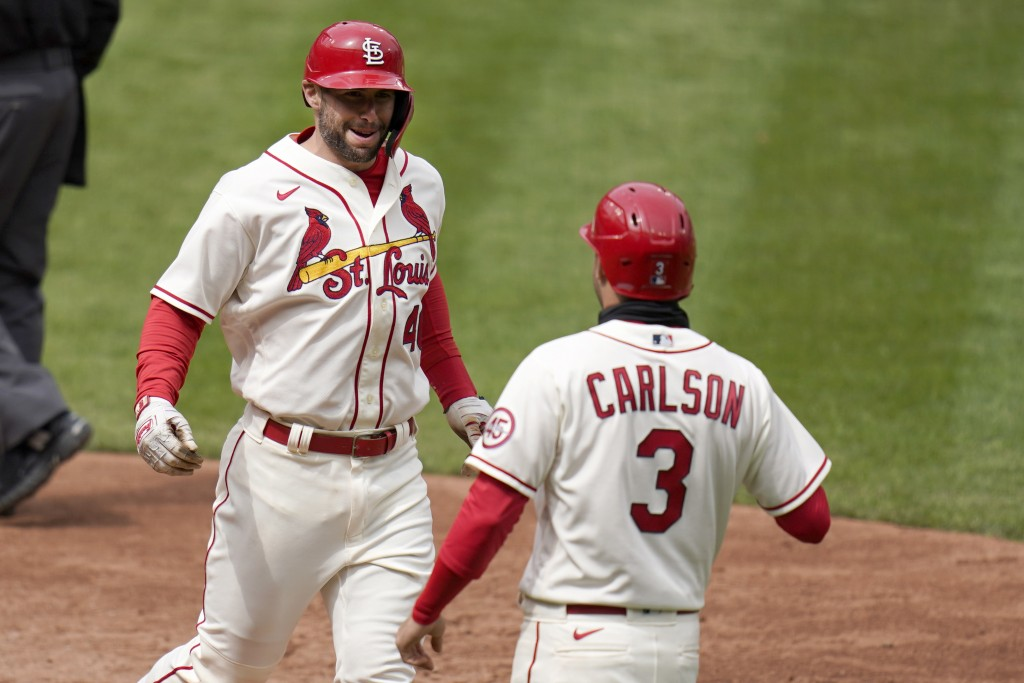 St. Louis Cardinals' Paul Goldschmidt, left, is congratulated by teammate Dylan Carlson (3) after hitting a two-run home run during the fifth inning o...