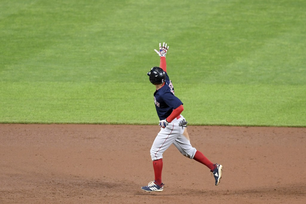Boston Red Sox's Xander Bogaerts celebrates as he rounds the bases after hitting a two-run home run against the Baltimore Orioles in the sixth inning ...