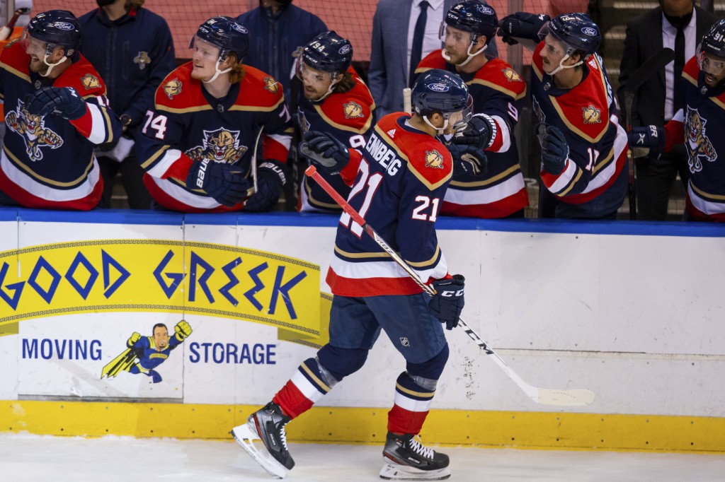 Florida Panthers center Alex Wennberg (21) celebrates with teammates after scoring a goal against the Tampa Bay Lightning during the first period of a...