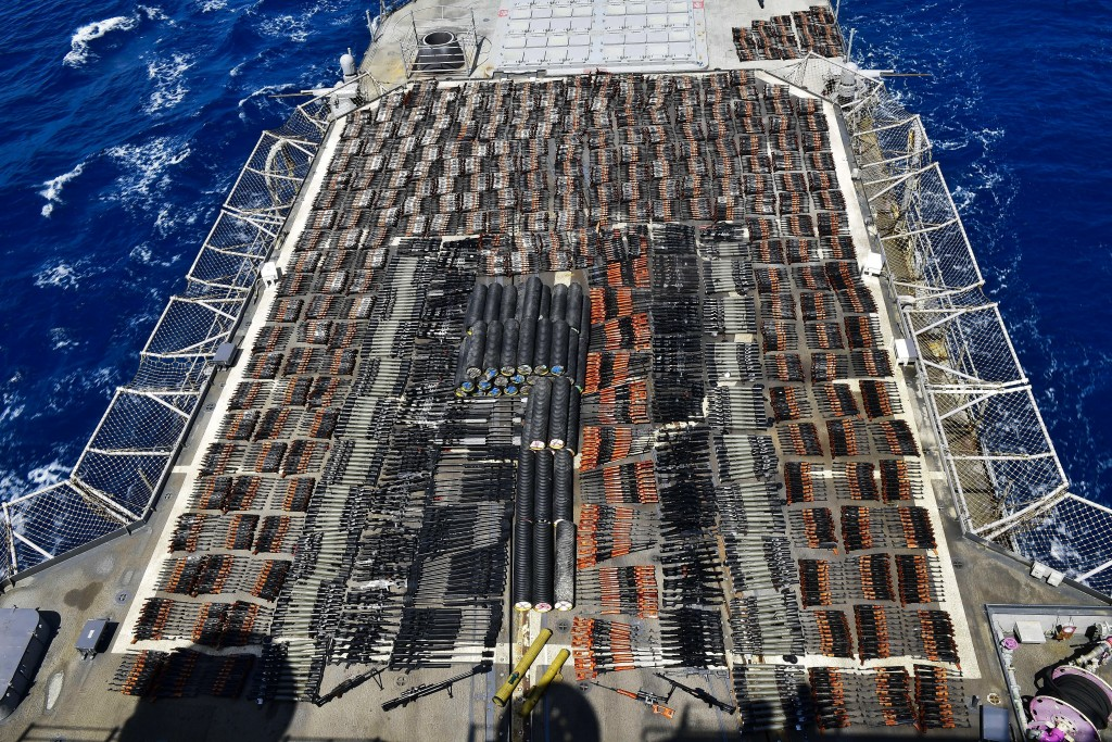 Weapons that the U.S. Navy described as coming from a hidden arms shipment aboard a stateless dhow are seen aboard the guided-missile cruiser USS Mont...