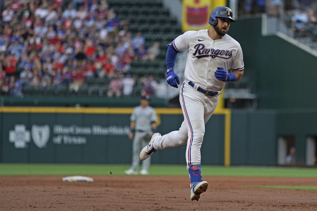 Texas Rangers center fielder Joey Gallo (13) rounds the bases after hitting a home run against the Seattle Mariners in the second inning of a baseball...