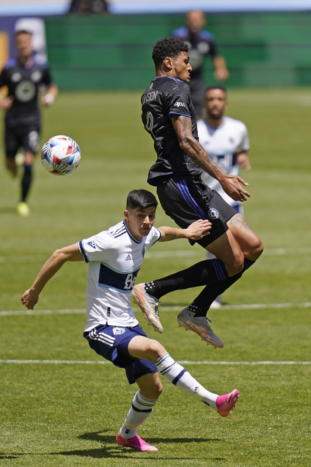 Vancouver Whitecaps defender Cristian Gutierrez, left, and CF Montréal forward Bjorn Johnsen (9) battle for the ball in the first half during an MLS s...