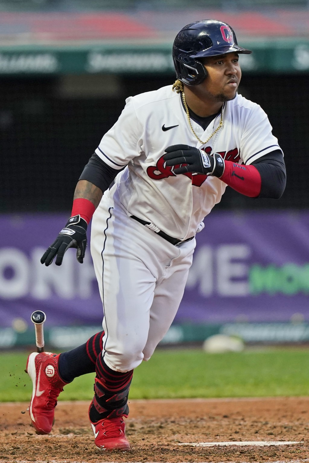 Cleveland Indians' Jose Ramirez watches his two-run double during the sixth inning of the team's baseball game against the Cincinnati Reds, Saturday, ...