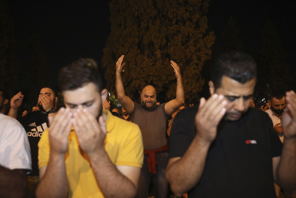 Worshippers pray during the Laylat al-Qadr, or the night of destiny, in the holy fasting month of Ramadan, in the Al Aqsa Mosque compound in Jerusalem...
