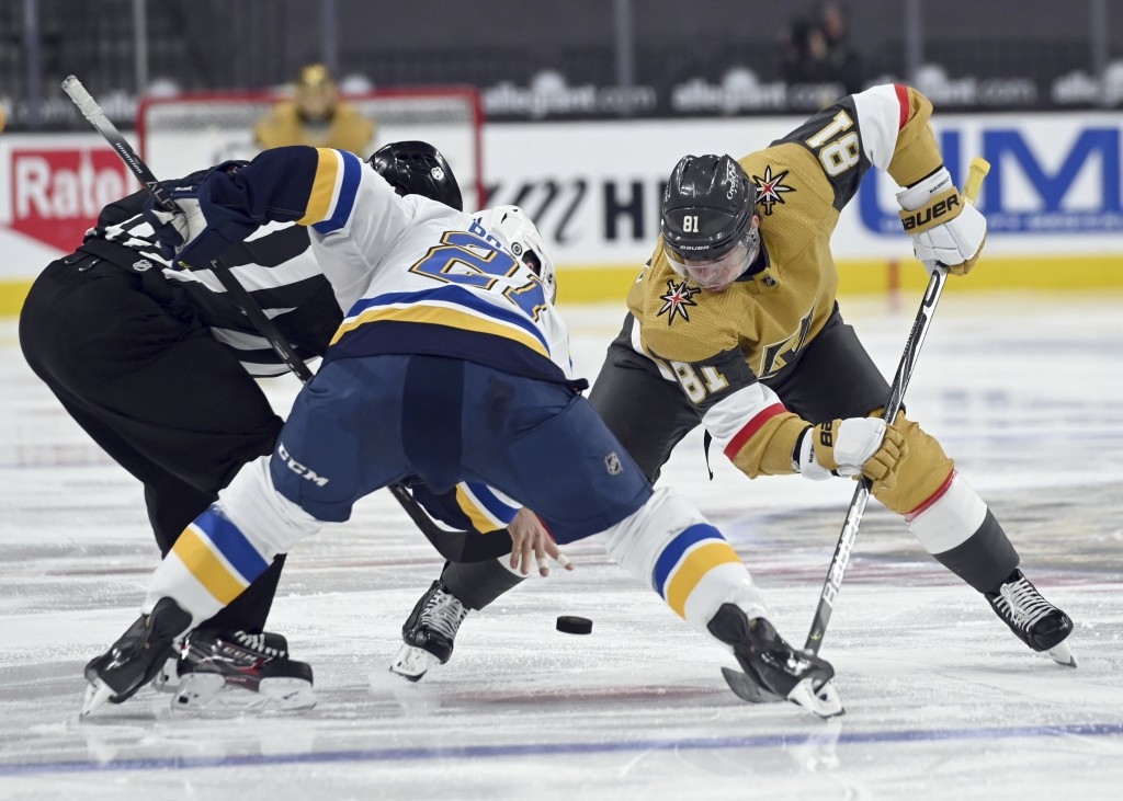 St. Louis Blues center Tyler Bozak (21) and Vegas Golden Knights center Jonathan Marchessault (81) face off during the second period of an NHL hockey ...
