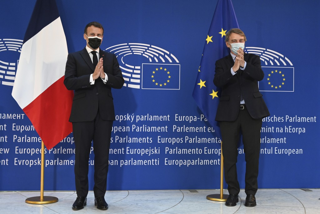 French President Emmanuel Macron, left and European Parliament President David Sassoli applaud during the Europe Day event and the Conference on the F...