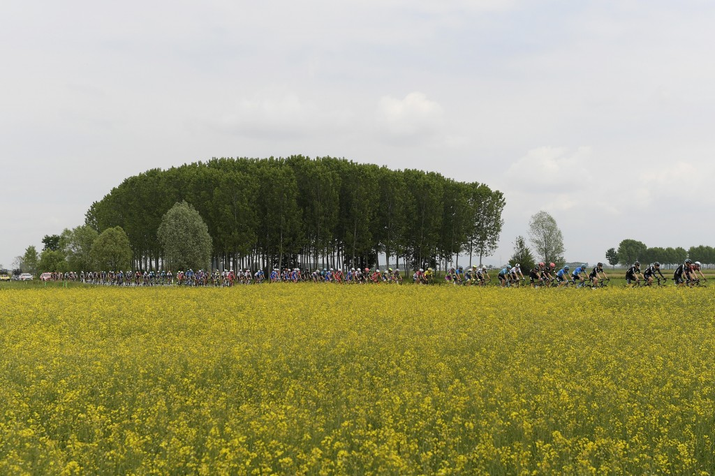 Cyclists pedal through the countryside during the second stage of the Giro d'Italia, tour of Italy cycling race from Stupinigi to Novara, Italy, Sunda...