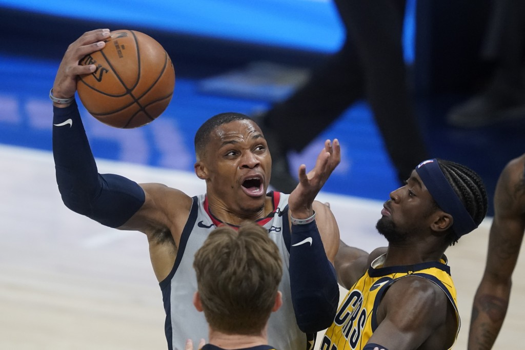 Washington Wizards' Russell Westbrook goes to the basket against Indiana Pacers' Caris LeVert (22) during the first half of an NBA basketball game Sat...