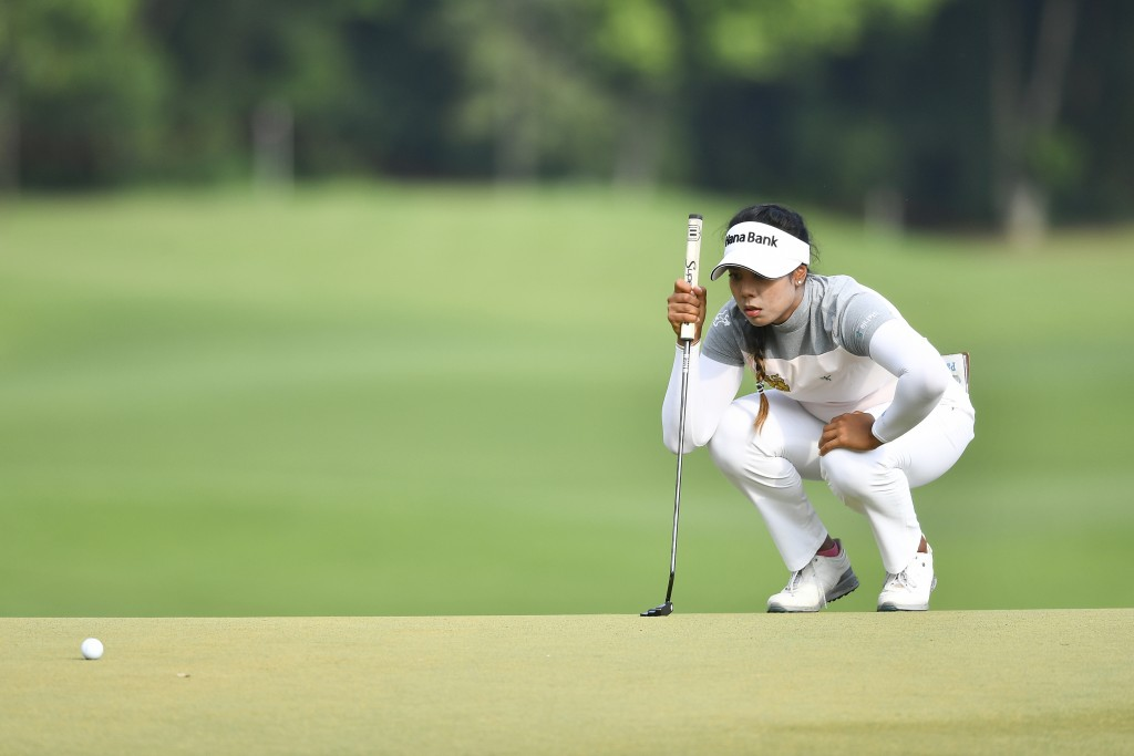 Patty Tavatanakit of Thailand lines up for a putt on the 18th hole during the final round of the LPGA Honda Thailand golf tournament in Pattaya, south...